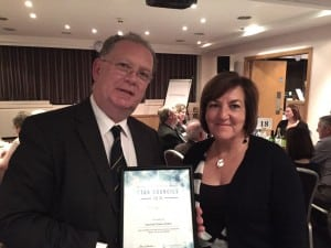 Andrea Gilbert, Inclusion Cornwall Manager and Mike Thomas, Helston Town Councillor, collect Star Council award.